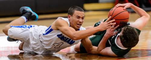 Trent Nelson  |  The Salt Lake Tribune Bingham's Dason Youngblood (4) and Olympus's Nate Fox (3) chase down a loose ball as Bingham plays Olympus in the first round of the boys' basketball Elite 8 Tournament at American Fork High School, Thursday December 10, 2015.