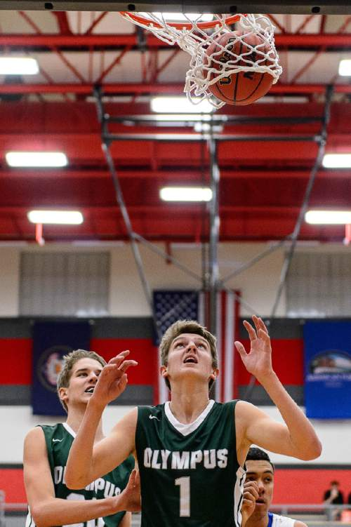 Trent Nelson  |  The Salt Lake Tribune Olympus's Isaac Monson (20) and Olympus's Travis Wagstaff (1) look up to the ball as Bingham plays Olympus in the first round of the boys' basketball Elite 8 Tournament at American Fork High School, Thursday December 10, 2015.
