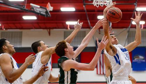 Trent Nelson  |  The Salt Lake Tribune Bingham's Samuta Avea (32) grabs a rebound as Bingham plays Olympus in the first round of the boys' basketball Elite 8 Tournament at American Fork High School, Thursday December 10, 2015.