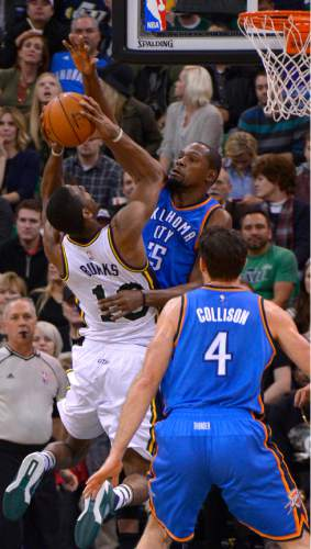 Leah Hogsten  |  The Salt Lake Tribune Oklahoma City Thunder forward Kevin Durant (35) blocks Utah Jazz guard Alec Burks (10) shot. Oklahoma City Thunder defeated the Utah Jazz 94-90 at Vivint Smart Home Arena, Friday, December 11, 2015.