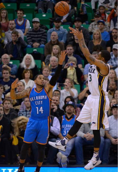 Leah Hogsten  |  The Salt Lake Tribune Utah Jazz guard Trey Burke (3) fires off a three. Oklahoma City Thunder defeated the Utah Jazz 94-90 at Vivint Smart Home Arena, Friday, December 11, 2015.