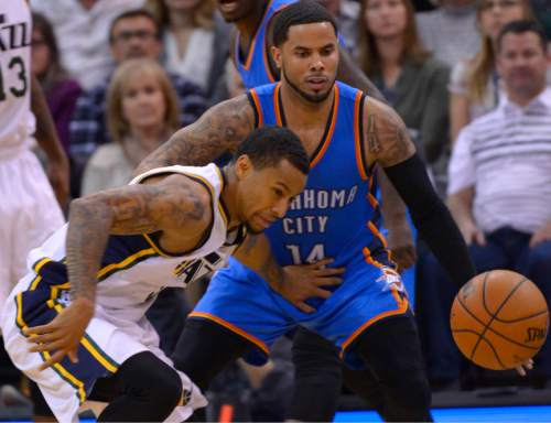 Leah Hogsten  |  The Salt Lake Tribune Utah Jazz guard Trey Burke (3) pushes off Oklahoma City Thunder guard D.J. Augustin (14) to get the steal. Oklahoma City Thunder defeated the Utah Jazz 94-90 at Vivint Smart Home Arena, Friday, December 11, 2015.