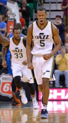 Leah Hogsten  |  The Salt Lake Tribune Utah Jazz guard Rodney Hood (5) reacts to knocking down a shot over Oklahoma City Thunder guard Dion Waiters (3). Oklahoma City Thunder defeated the Utah Jazz 94-90 at Vivint Smart Home Arena, Friday, December 11, 2015.