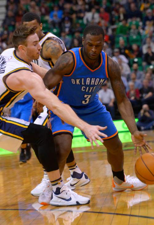 Leah Hogsten  |  The Salt Lake Tribune Utah Jazz forward Gordon Hayward (20) tries to steal from Oklahoma City Thunder guard Dion Waiters (3). Oklahoma City Thunder defeated the Utah Jazz 94-90 at Vivint Smart Home Arena, Friday, December 11, 2015.