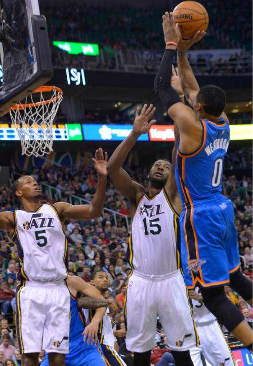 Leah Hogsten  |  The Salt Lake Tribune Utah Jazz forward Derrick Favors (15) tries to block Oklahoma City Thunder guard Russell Westbrook (0). Oklahoma City Thunder defeated the Utah Jazz 94-90 at Vivint Smart Home Arena, Friday, December 11, 2015.