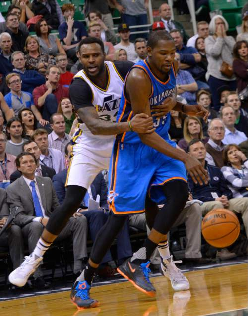 Leah Hogsten  |  The Salt Lake Tribune Utah Jazz forward Trevor Booker (33) fouls Oklahoma City Thunder forward Kevin Durant (35) to drive him to the foul line in the final seconds of the game. Oklahoma City Thunder defeated the Utah Jazz 94-90 at Vivint Smart Home Arena, Friday, December 11, 2015.