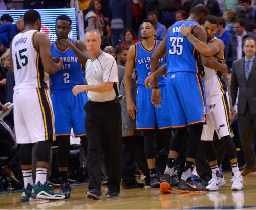 Leah Hogsten  |  The Salt Lake Tribune Utah Jazz forward Derrick Favors (15) hugs Oklahoma City Thunder guard Anthony Morrow (2) left and Utah Jazz guard Alec Burks (10) hugs Oklahoma City Thunder forward Kevin Durant (35) after the game. Oklahoma City Thunder defeated the Utah Jazz 94-90 at Vivint Smart Home Arena, Friday, December 11, 2015.