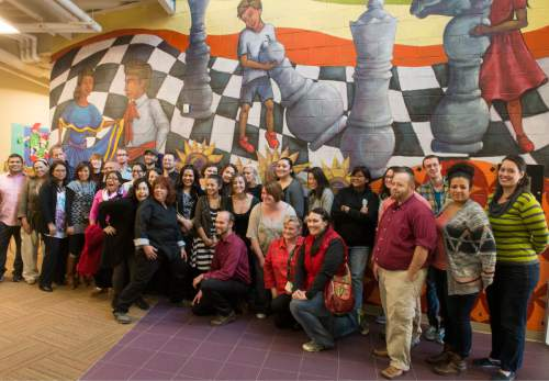 Rick Egan  |  The Salt Lake Tribune  Artists and teachers gather for photo after The University of Utah Special Topics Art Class and Professor V. Kim Martinez unveiled the1500 square foot mural at Esperanza Elementary School in West Valley City, Friday, December 11, 2015.