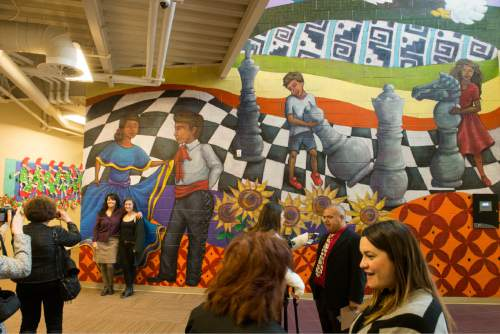 Rick Egan  |  The Salt Lake Tribune  Artists and teachers gather as University of Utah professor V. Kim Martinez unveiled an1500 square foot mural at Esperanza Elementary School in West Valley City, Friday, December 11, 2015.