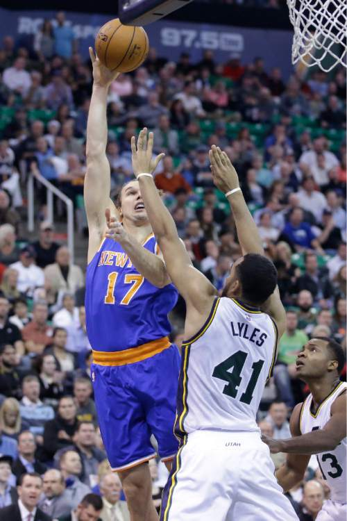 New York Knicks forward Lou Amundson (17) shoots as Utah Jazz forward Trey Lyles (41) defends during the second half of an NBA basketball game Wednesday, Dec. 9, 2015, in Salt Lake City. The Jazz won 106-85. (AP Photo/Rick Bowmer)