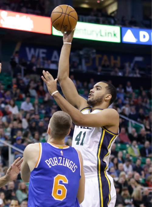 Utah Jazz forward Trey Lyles (41) shoots as New York Knicks forward Kristaps Porzingis (6) defends in the first quarter during an NBA  basketball game Wednesday, Dec. 9, 2015, in Salt Lake City. (AP Photo/Rick Bowmer)