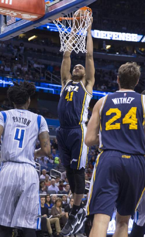 Utah Jazz forward Trey Lyles (41) dunks in front of Orlando Magic guard Elfrid Payton (4) and teammate Jeff Withey (24) during the second half of an NBA basketball game in Orlando, Fla., Friday, Nov. 13, 2015. Magic won 102-93. (AP Photo/Willie J. Allen Jr.)
