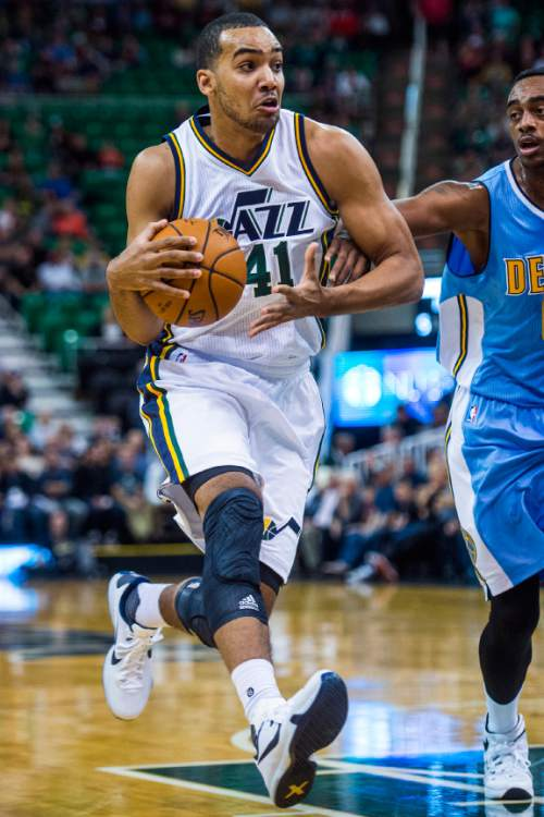 Chris Detrick  |  The Salt Lake Tribune Utah Jazz forward Trey Lyles (41) is guarded by Denver Nuggets forward Darrell Arthur (00) during the game at EnergySolutions Arena Thursday October 22, 2015.