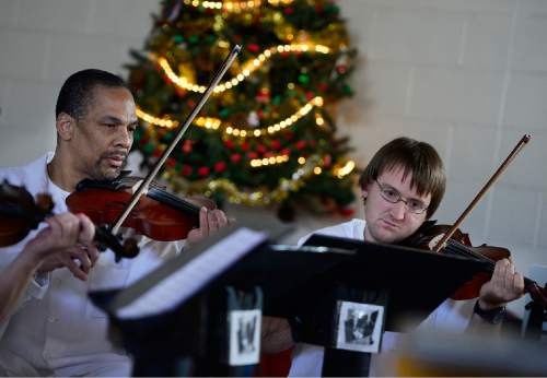 Scott Sommerdorf   |  The Salt Lake Tribune Inmates in the string section perform during the annual Christmas concert of the Wasatch Music Education Program at the Utah State Prison on Saturday.