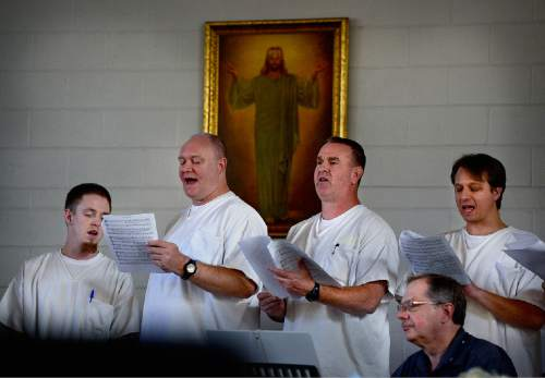 "Scott Sommerdorf   |  The Salt Lake Tribune Inmates sings ""The Carol of the Bells"" at the annual Christmas concert of the Wasatch Music Education Program at the Utah State Prison on Saturday."