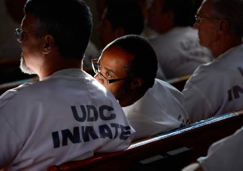 Scott Sommerdorf   |  The Salt Lake Tribune An inmate leans over to get a better look at the performance during the annual Christmas concert of the Wasatch Music Education Program at the Utah State Prison on Saturday, Dec. 12, 2015.