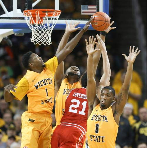 Wichita State's Zach Brown, left, Shaquille Morris and Rashard Kelly, right, defend against Utah forward Jordan Loveridge during the first half of an NCAA college basketball game, Saturday, Dec. 12, 2015 in Wichita, Kan. (Travis Heying/The Wichita Eagle via AP) LOCAL TELEVISION OUT; MAGS OUT; LOCAL RADIO OUT; LOCAL INTERNET OUT; MANDATORY CREDIT