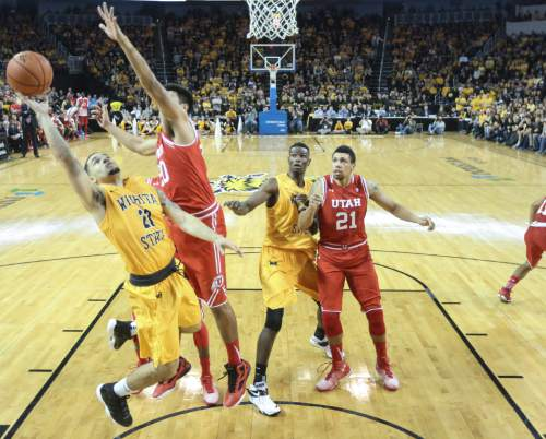 Wichita State guard Fred VanVleet , left, goes to the basket against Utah forward Chris Reyes during the second half of an NCAA college basketball game, Saturday, Dec. 12, 2015 in Wichita, Kan. (Travis Heying/The Wichita Eagle via AP) LOCAL TELEVISION OUT; MAGS OUT; LOCAL RADIO OUT; LOCAL INTERNET OUT; MANDATORY CREDIT