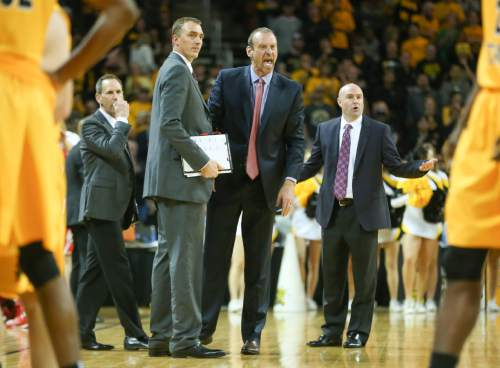 Utah head coach Larry Krystkowiak, center, yells at the referee after he was assessed a technical foul during the second half of an NCAA college basketball game against Wichita State, Saturday, Dec. 12, 2015 in Wichita, Kan. (Travis Heying/The Wichita Eagle via AP) LOCAL TELEVISION OUT; MAGS OUT; LOCAL RADIO OUT; LOCAL INTERNET OUT; MANDATORY CREDIT