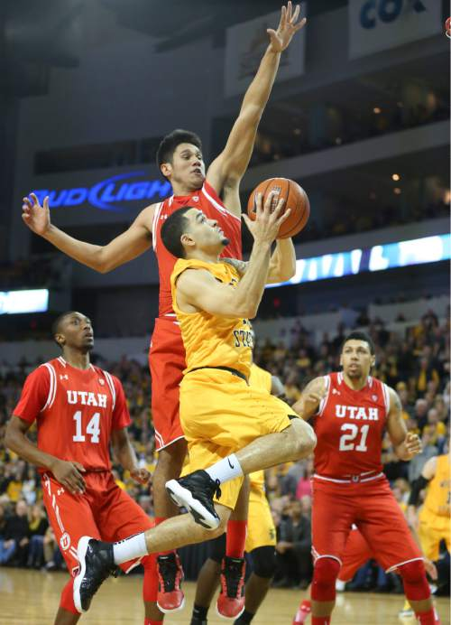Wichita State guard Fred VanVleet  goes to the basket against Utah forward Kyle Kuzma during the second half of an NCAA college basketball game, Saturday, Dec. 12, 2015 in Wichita, Kan. (Travis Heying/The Wichita Eagle via AP) LOCAL TELEVISION OUT; MAGS OUT; LOCAL RADIO OUT; LOCAL INTERNET OUT; MANDATORY CREDIT