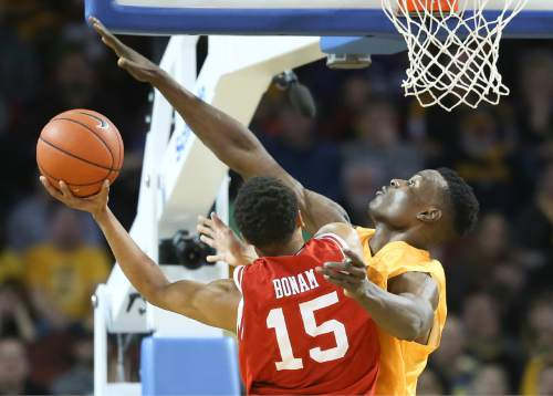 Wichita State center Bush Wamukota defends against Utah guard Lorenzo Bonam during the first half of an NCAA college basketball game, Saturday, Dec. 12, 2015 in Wichita, Kan. (Travis Heying/The Wichita Eagle via AP) LOCAL TELEVISION OUT; MAGS OUT; LOCAL RADIO OUT; LOCAL INTERNET OUT; MANDATORY CREDIT