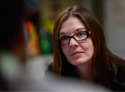 Scott Sommerdorf   |  The Salt Lake Tribune Nicole Lowe speaks with one of the staff at the VOA homeless youth center on State Street, Thursday, December 5, 2015. Lowe was once homeless and a drug user. Now she is an attorney with the A.G.'s office. She donates her own time to help homeless people with legal issues.