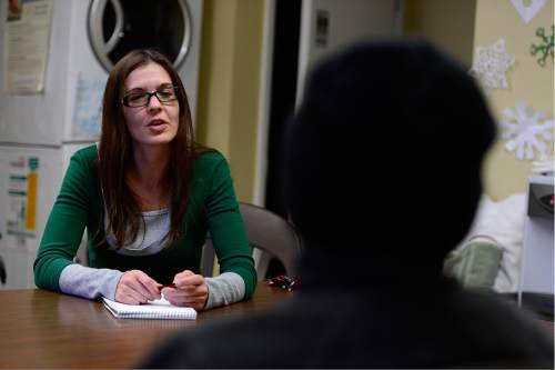 Scott Sommerdorf   |  The Salt Lake Tribune Nicole Lowe meets with a homeless man at the VOA homeless youth center on State Street, Thursday, December 10, 2015. Lowe was once homeless and a drug user. Now she is an attorney with the A.G.'s office. She donates her own time to help homeless people with legal issues.