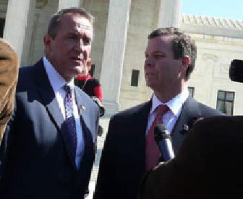 Matt Canham  |  The Salt Lake Tribune  Attorney General Mark Shurtleff and his chief deputy John Swallow record their observations of the Supreme Court hearing on the individual mandate.