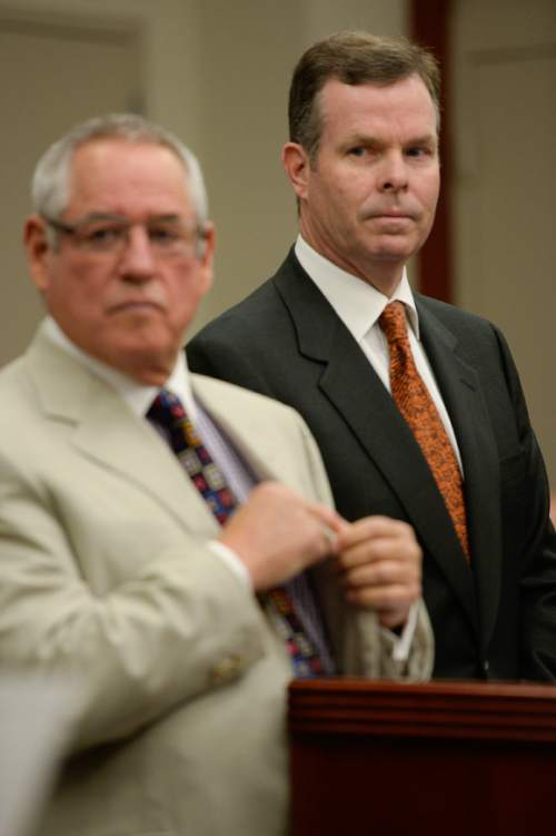 Francisco Kjolseth | The Salt Lake Tribune Former Utah Attorney General John Swallow, right,  appears at the Matheson Courthouse in Salt Lake City on Monday, July, 27, 2015, alongside his attorney Steve McCaughey for an arraignment hearing. Swallow had his attorney plead not guilty on his behalf to more than a dozen criminal charges of corruption.