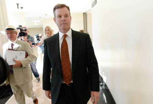 Francisco Kjolseth | The Salt Lake Tribune Former Utah Attorney General John Swallow, right, exits the Matheson Courthouse in Salt Lake City on Monday, July, 27, 2015, alongside his attorney Steve McCaughey. Swallow who appeared for an arraignment hearing had his attorney plead not guilty on his behalf to more than a dozen criminal charges of corruption. McCaughey is no longer Swallow's attorney.