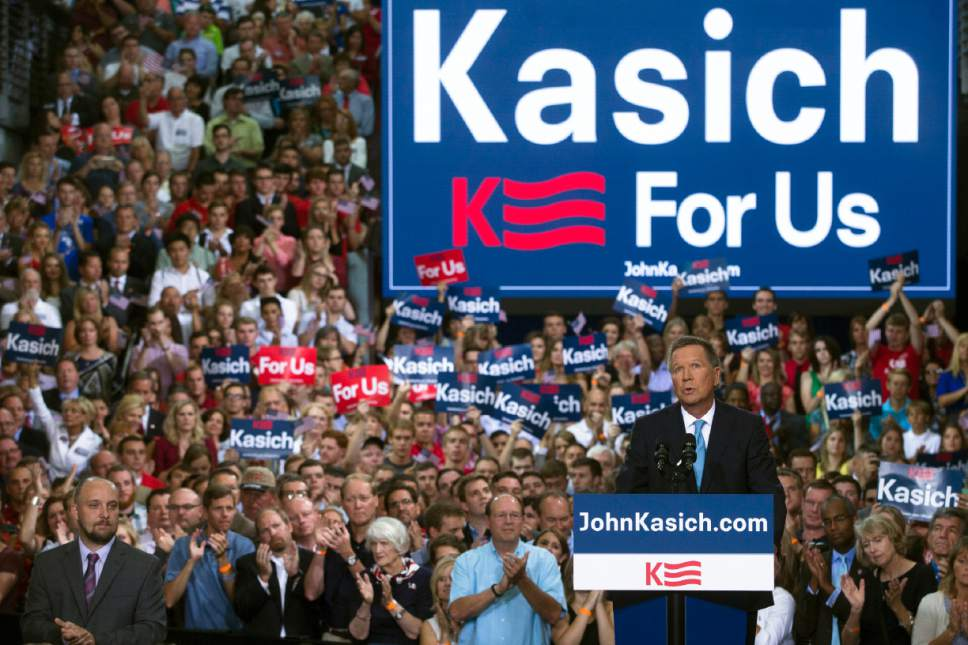 Ohio Gov. John Kasich announces he is running for the 2016 Republican party's nomination for president during a campaign rally at Ohio State University, Tuesday, July 21, 2015, in Columbus, Ohio. Kasich, a two-term governor and former congressman, has little name recognition in the crowded GOP field, but he is already airing television ads in New Hampshire where he is heading immediately after making his run official. (AP Photo/John Minchillo)