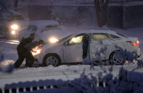 Al Hartmann  |  The Salt Lake Tribune Monday morning  was a nightmare for those commuting to work by car like this car stuck on 2700 South in Salt Lake City.  Cars slid off roads and became stuck as the snow falls Monday morning Dec. 14.