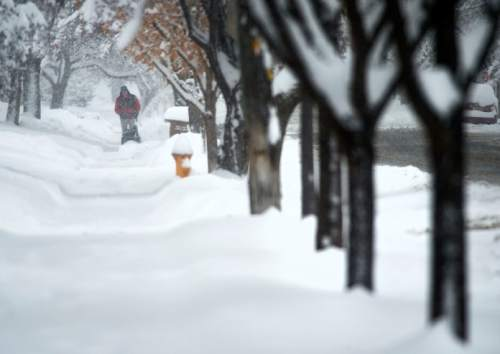 Steve Griffin  |  The Salt Lake Tribune  Snow blowers and shovels were out in force in Salt Lake City as a major storm dumped snow through out the sate Monday, December 14, 2015.