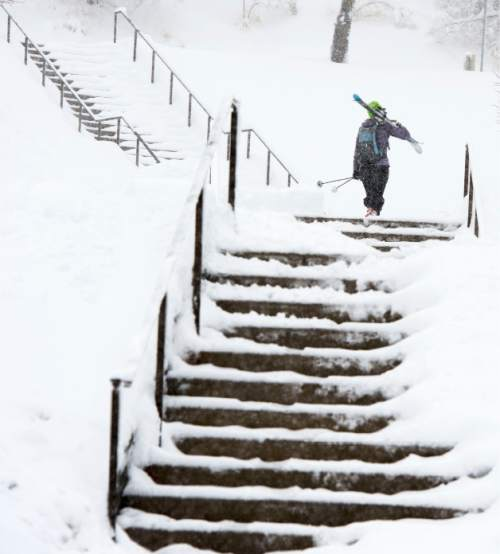 Steve Griffin  |  The Salt Lake Tribune  Snow removal crews work to keep the stairs at the Utah Sate Capitol cleat as a major storm dumped snow through out the sate in Salt Lake City, Monday, December 14, 2015.