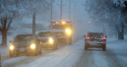 Al Hartmann  |  The Salt Lake Tribune Monday morning  was a nightmare for those commuting to work by car  in Salt Lake City.  Cars slid off roads and became stuck as the snow falls Monday morning Dec. 14.
