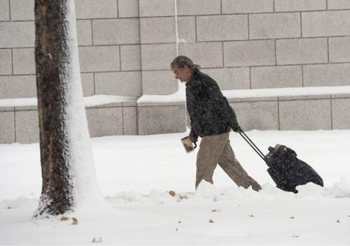 Al Hartmann  |  The Salt Lake Tribune Monday morning  was a nightmare for those commuting to work by car in Salt Lake City as the snow falls Monday morning Dec. 14.  It wasn't easy for those on foot either.