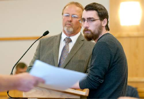 John Zsiray  |  Pool Photo  Ryan Wray, right, watches a bailiff pass documents to prosecutors in 1st District Court Judge Kevin K. Allen's courtroom with his lawyer Shannon Demler on Monday October 26, 2015 in Logan. Wray pleaded guilty to inappropriately touching an unconscious female during a frat party.