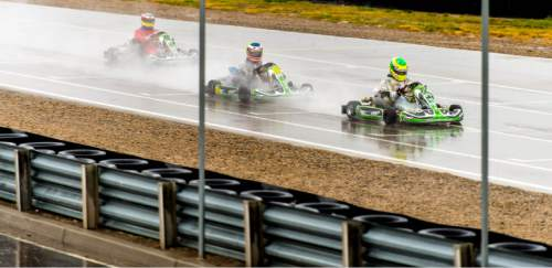 Trent Nelson  |  The Salt Lake Tribune Heavy rain doesn't stop racers on the track for the Utah Kart Championship at Miller Motorsports Park, which kicked off its 2014 season with racing and a car show Saturday April 26, 2014.