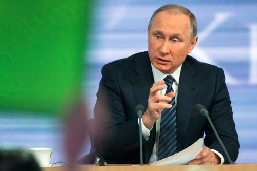 Russian President Vladimir Putin speaks during his annual news conference in Moscow, Russia, Thursday, Dec. 17, 2015. Putin says that Russia's economy is showing signs of stabilization despite plummeting oil prices. Putin, speaking Thursday at a news conference televised live, said that despite a GDP drop caused by a drop in global oil prices, Russia's main commodity, the nation's industries have started to rebound. (AP Photo/Alexander Zemlianichenko)