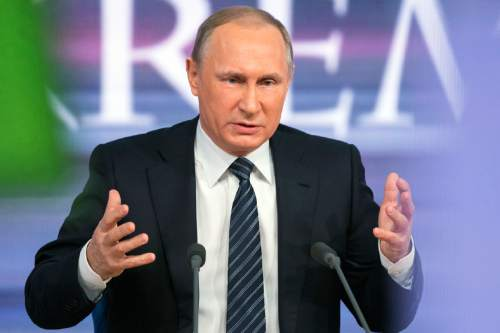 Russian President Vladimir Putin speaks during his annual news conference in Moscow, Russia, Thursday, Dec. 17, 2015. President Vladimir Putin says Turkey acted contrary to its own interests by downing a Russian warplane. Speaking at a televised news conference Thursday, Putin said that he sees no possibility of overcoming the diplomatic strain under the current Turkish leadership. (AP Photo/Alexander Zemlianichenko)