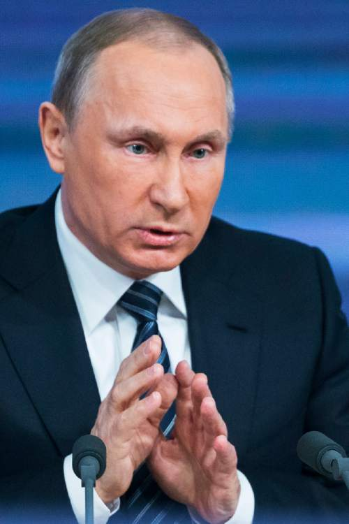 Russian President Vladimir Putin gestures during his annual news conference in Moscow, Russia, Thursday, Dec. 17, 2015. Putin says that Russia's economy is showing signs of stabilization despite plummeting oil prices. Putin, speaking Thursday at a news conference televised live, said that despite a GDP drop caused by a drop in global oil prices, Russia's main commodity, the nation's industries have started to rebound. (AP Photo/Alexander Zemlianichenko)