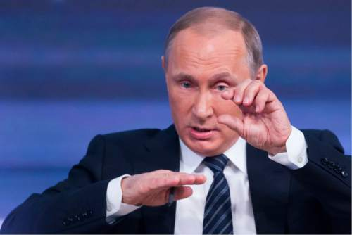 Russian President Vladimir Putin speaking at his annual end of year news conference in Moscow, Russia, Thursday, Dec. 17, 2015. President Vladimir Putin said Thursday Russia is ready to improve ties with the United States and work with whomever is elected its next president. (AP Photo/Alexander Zemlianichenko)