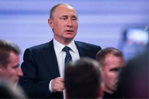 Russian President Vladimir Putin speaks to  journalists after his annual end of year news conference in Moscow, Russia, Thursday, Dec. 17, 2015. President Vladimir Putin said Thursday Russia is ready to improve ties with the United States and work with whomever is elected its next president. (AP Photo/Alexander Zemlianichenko)