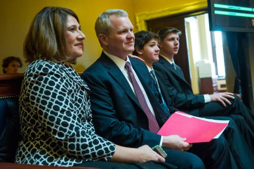 Chris Detrick  |  The Salt Lake Tribune Utah Supreme Court Justice nominee John Pearce, his wife Jennifer Napier-Pearce and sons Jonas, 14, and Ben, 17, listen while he is confirmed by the Senate at the Utah State Capitol on Wednesday.