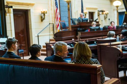 Chris Detrick  |  The Salt Lake Tribune Utah Supreme Court Justice nominee John Pearce, his wife Jennifer Napier-Pearce and sons Jonas, 14, and Ben, 17, listen while he is confirmed by the Senate at the Utah State Capitol Wednesday December 16, 2015.