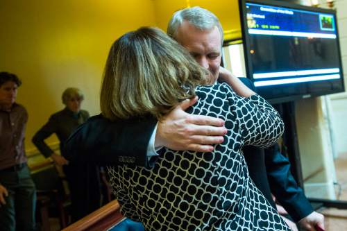 Chris Detrick  |  The Salt Lake Tribune Utah Supreme Court Justice nominee John Pearce hugs his wife Jennifer Napier-Pearce after being confirmed by the Senate at the Utah State Capitol Wednesday December 16, 2015.