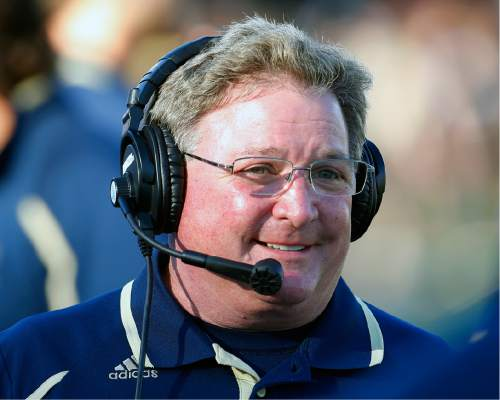 Akron head coach Terry Bowden walks the sidelines during the first half of an NCAA college football game against Northern Illinois, Saturday, Oct. 12 , 2013, in DeKalb, Ill. (AP Photo/Jeff Haynes)
