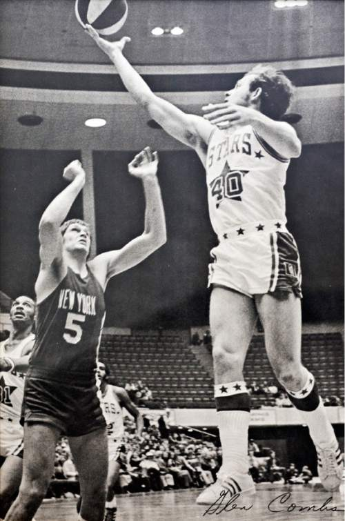 Utah Stars guard Glen Combs (40) lays the ball up over New York Nets forward Billy Paultz (5) during an ABA basketball game.  Photos provided by Mr. Mac