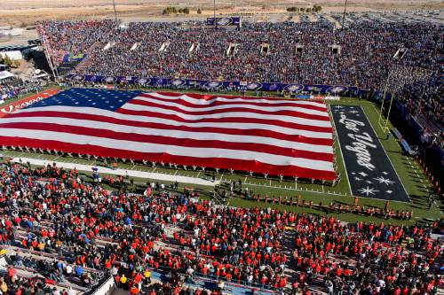 Trent Nelson  |  The Salt Lake Tribune A large flag covers the field before the start of the game as Utah faces BYU in the Royal Purple Las Vegas Bowl, NCAA football at Sam Boyd Stadium in Las Vegas, Saturday December 19, 2015.