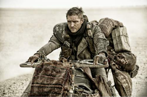 "This photo provided by Warner Bros. Pictures shows Tom Hardy, as Max Rockatansky, in Warner Bros. Pictures' and Village Roadshow Pictures' action adventure film, ""Mad Max:Fury Road,"" a Warner Bros. Pictures release. (Jasin Boland/Warner Bros. Pictures via AP)"